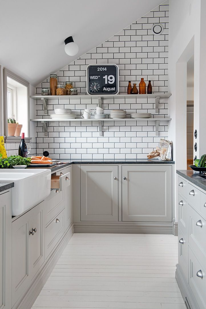 Gray Kitchen RoundUp Kassandra DeKoning - Light grey painted kitchen cabinets