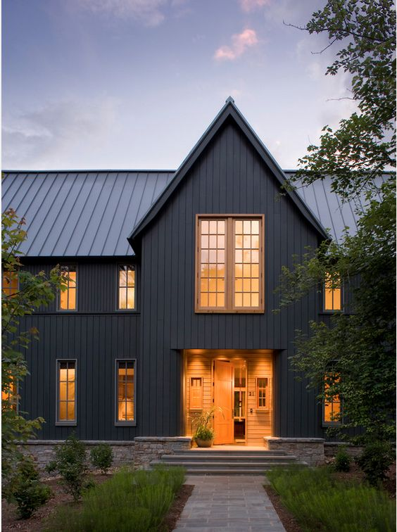 Contemporary modern farmhouse exteriors kassandra dekoning for Black and white house exterior design